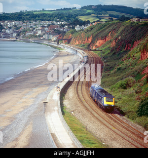 The railway along the sea wall at Dawlish near Langstone Rock with a pair of Great Western class 43 locomotives - Stock Photo