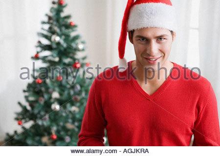 Man wearing a santa hat - Stock Photo