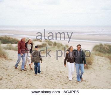 Family walking along beach - Stock Photo