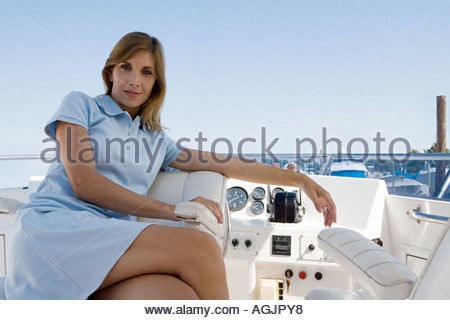 Woman sitting on a yacht - Stock Photo