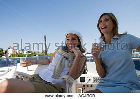 Friends sitting on a yacht - Stock Photo