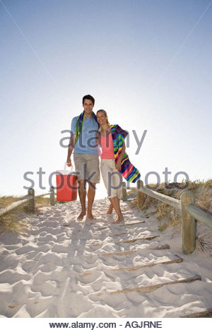 Couple going for picnic on the beach - Stock Photo
