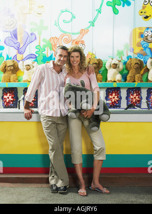 Couple by fairground stall - Stock Photo
