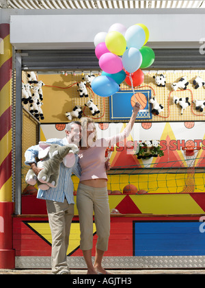 Couple at fairground - Stock Photo