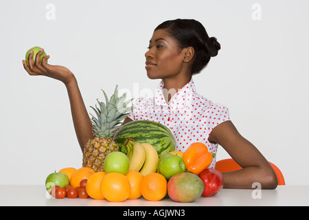 Young woman holding an apple - Stock Photo