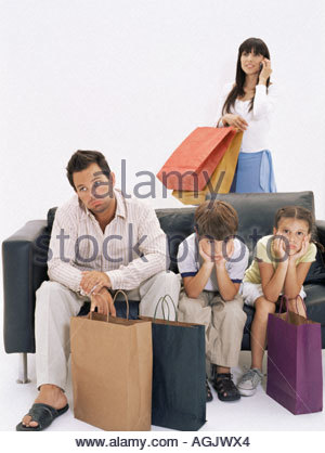 Bored family waiting for mother - Stock Photo