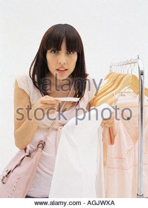Woman holding price label - Stock Photo
