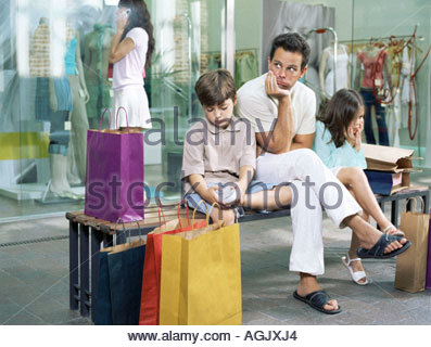 Family bored with waiting - Stock Photo