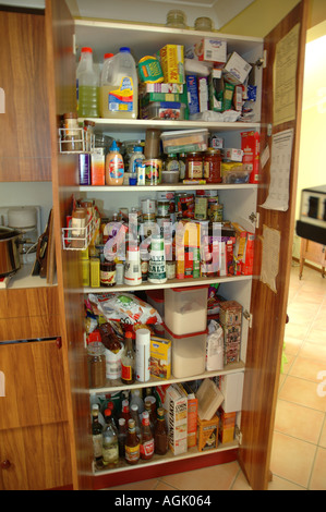 Over stocked larder in country home with teenagers dsc 0830 - Stock Photo
