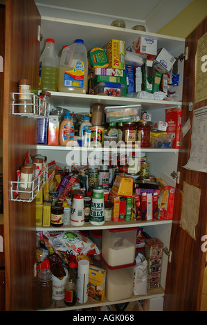 Over stocked larder in country home with teenagers dsc 0838 - Stock Photo
