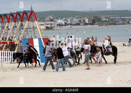 Donkey rides on Weymouth Beach. - Stock Photo