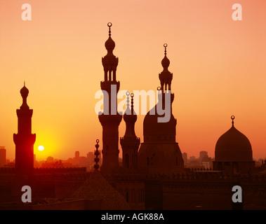 Domes and minaretes at sunset Cairo Egypt - Stock Photo