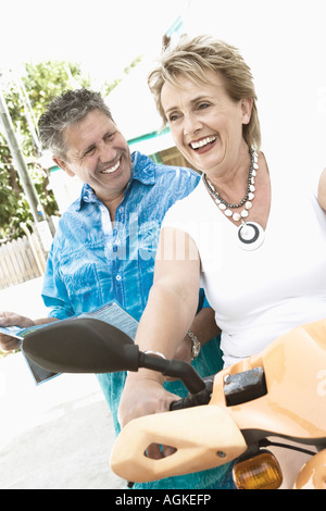 Close-up of a senior man and a mature woman smiling - Stock Photo
