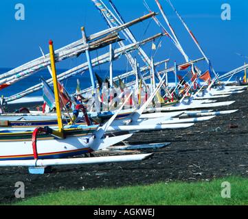 Indonesia Bali Sanur fishing boats on beach low angle - Stock Photo