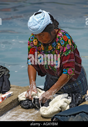 Woman in Guatemala washing clothes in the river Stock ...