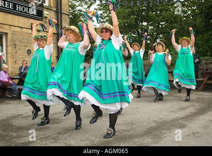 The women of the Buttercross Belles Morris Dancers morris dancing at a Folk Festival, UK - Stock Photo