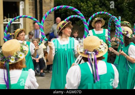 Buttercross Belles morris dancers dancing at a Folk Festival Yorkshire England UK - Stock Photo