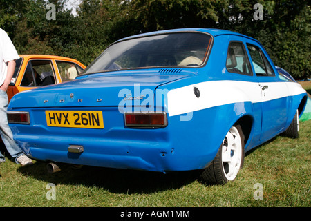 modified classic blue Ford Escord car show