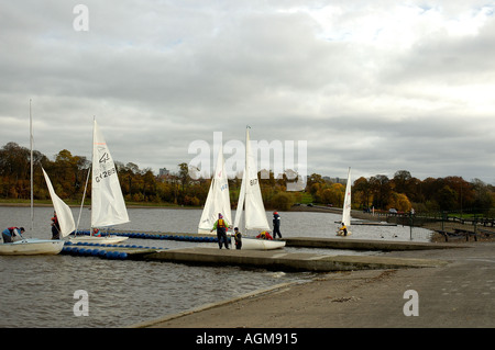 dinghy sailors on Strathclyde Loch Strathclyde Country Park Motherwell Lanarkshire Scotland - Stock Photo