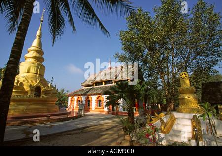 China Yunnan Xishuangbanna Gasa village temple compound and pagoda - Stock Photo