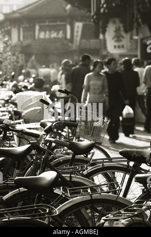 Bicycles on Old Street in Shanghai, China - Stock Photo