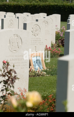 The graves of British servicemen killed in the Normandy Campaign at rest in the Commonwealth War Graves Cemetery - Stock Photo