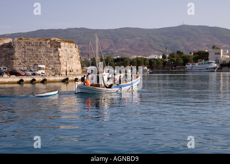 dh Harbour KOS TOWN GREECE KOS Fishing boat arriving harbour by Castle of Neratzia Knights of St John - Stock Photo
