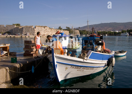 dh Harbour KOS TOWN GREECE KOS Fishing boat arriving at quayside Castle of Neratzia Knights of St John - Stock Photo