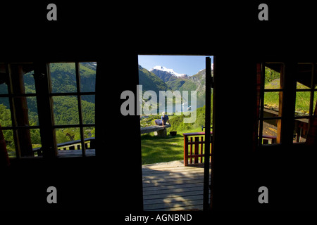 View of the Geirangerfjord from inside a vacation cabin Geiranger Norway - Stock Photo