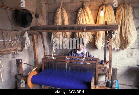 Ecuador Otovalo Senior man weaving - Stock Photo