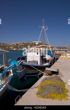 dh Kamari KAMARI BAY GREECE KOS Fishing boats and fish nets alongside quay pier harbour - Stock Photo