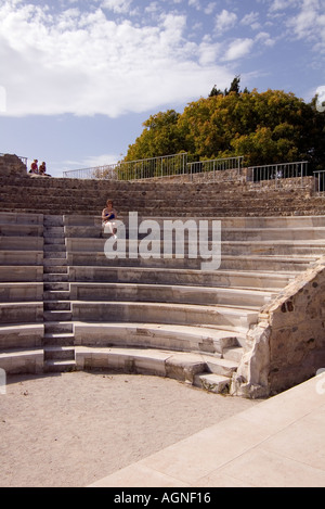 dh Odeon amphitheatre KOS TOWN GREECE KOS The Odeon amphitheatre from the stage and woman and girls sitting on seats - Stock Photo