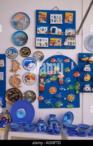 dh  KOS TOWN GREECE KOS Tourist shop blue pottery plates picture wall plaques momento presents - Stock Photo