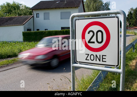 Markt Schwaben, GER, 26. June 2006 - A car passes a sign which marks the begin of a speed limited zone in Markt - Stock Photo
