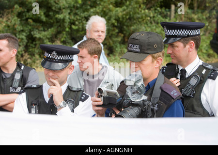 police photographer, photographing the protestors at the climate camp - Stock Photo