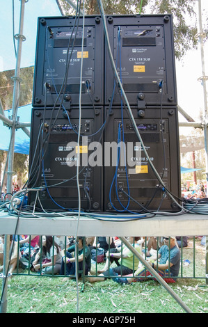 The back side of a Large bank of Loudspeakers on the side of a stage at an outdoor music concert - Stock Photo