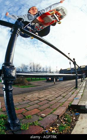 Skateboarder Ollies Handrail in London - Stock Photo