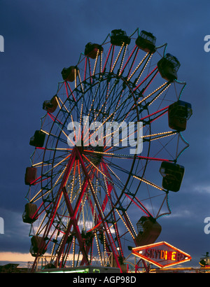 Fairground ride at night; 'The Hoppings' on the Town Moor, Newcastle upon Tyne, Tyne and Wear, England, UK. - Stock Photo