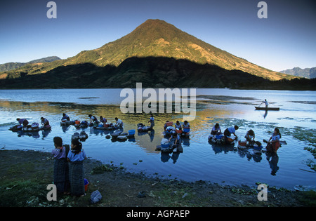 Guatemala Santiago de Atitlan, Women washing in lake Lago De Atitlan - Stock Photo