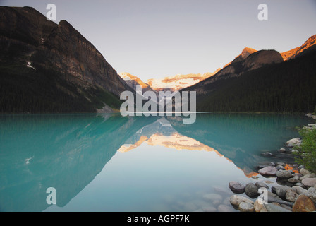 Lake Louise at sunrise at Banff National Park in Alberta Canada - Stock Photo