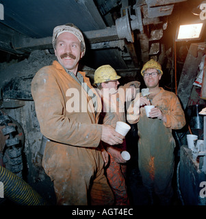Channel tunnel workers, 40 metres under the seabed on the service tunnel boring machine, pause for a tea break. - Stock Photo