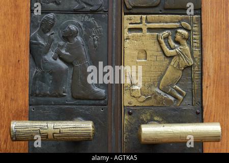 Door handles of the Franciscan church. Salzburg, Austria. - Stock Photo
