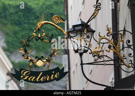 Wrought iron sign on Getreidegasse street. Salzburg, Austria. - Stock Photo
