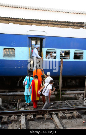 India Haridvar railway station platform travellers indians train second class compartment passengers getting on - Stock Photo