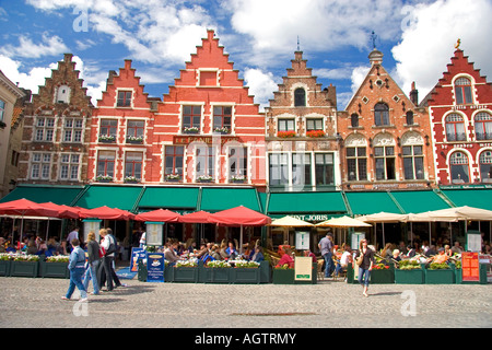 Cafes line The Big Market Square at Bruges in the province of West Flanders Belgium - Stock Photo