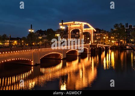 Skinny Bridge Magrere Brug at night Amsterdam Holland The Netherlands - Stock Photo