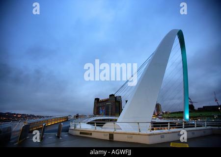 Side View Of The Gateshead Millennium Bridge With The Baltic (Centre For Contemporary Art), Gateshead - Newcastle, - Stock Photo