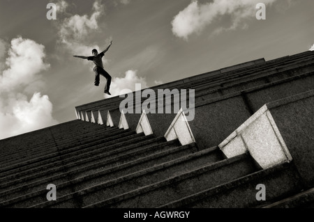 jump from stairs into the sky - Stock Photo