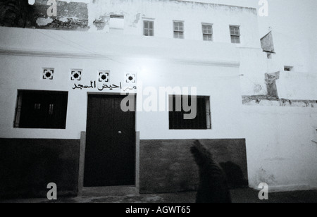 Eerie sinister twilit scene in the souk medina in Asilah in Morocco in the Maghreb in North Africa Sahara. Night - Stock Photo