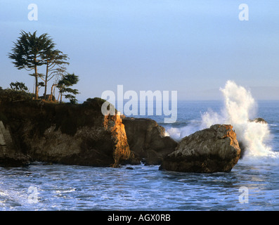 Waves crash into rocks and cliffs along the California Central Coast near Pismo Beach and San Luis Obispo. - Stock Photo
